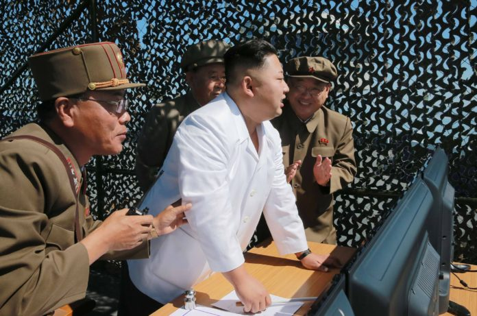 This undated picture released from North Korea's official Korean Central News Agency (KCNA) on September 20, 2016 shows North Korean leader Kim Jong-Un (C) inspecting the ground jet test of a new type high-power engine of a carrier rocket for the geo-stationary satellite at the Sohae Space Center in North Korea. North Korea has successfully tested a new, high-powered rocket engine, state media said, a move Seoul said was designed to showcase its progress towards being able to target the US east coast. / AFP PHOTO / KCNA / KCNA