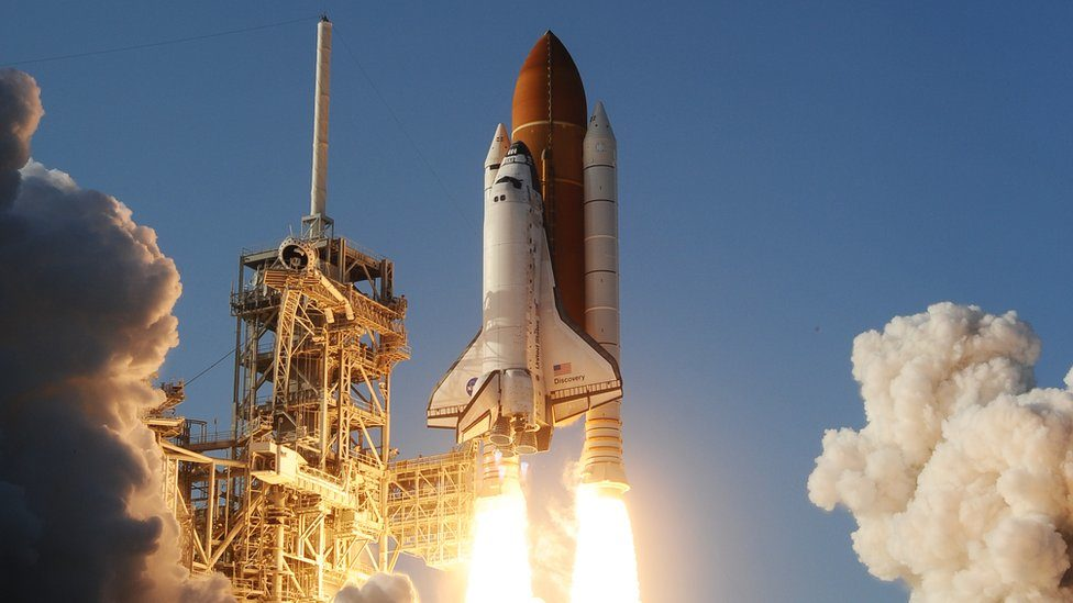 The launch of the space shuttle Discovery on a mission to the International Space Station