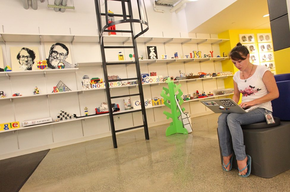 A woman works near the Lego section on the 4th floor of Google's headquarters in Manhattan, NY, on August 22, 2013.
