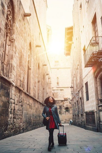 Young female tourist walking on an old street in Barcelona, Catalonia