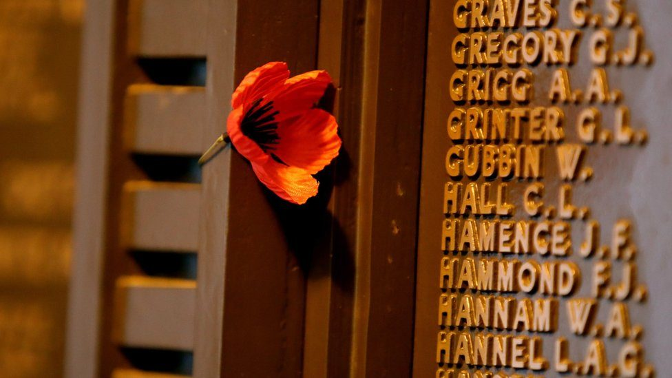 Poppies and crosses with the names of the fallen are displayed during Remembrance Day in Adelaide, Australia, 11 November 2018