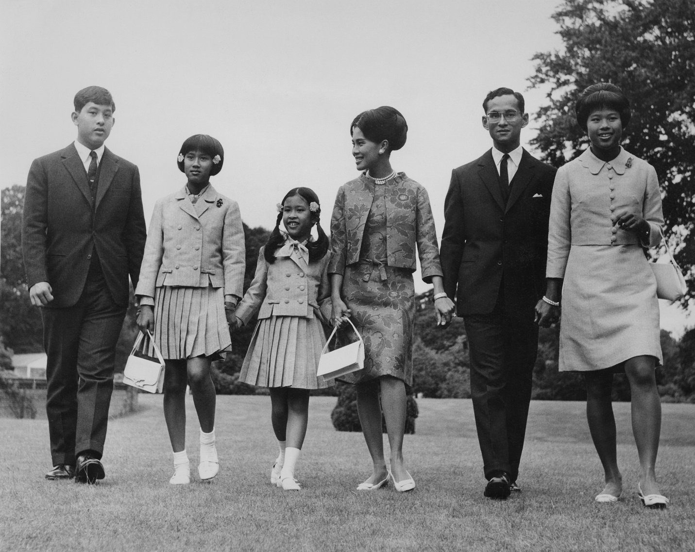 King Bhumibol and Queen Sirikit of Thailand with their children at King's Beeches, their private residence in Sunninghill, Berkshire, 27th July 1966.