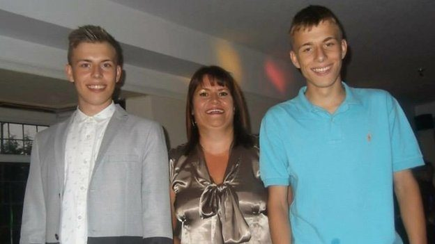 Alex with his mother and twin brother