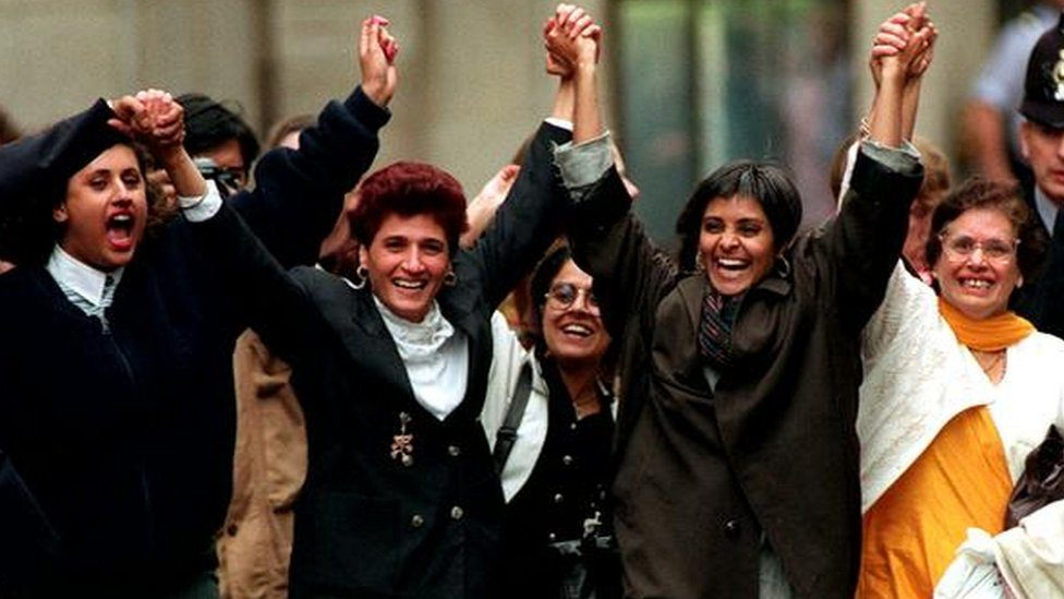 Kiranjit Ahluwalia holds hands with Southall Black Sisters as she is released.