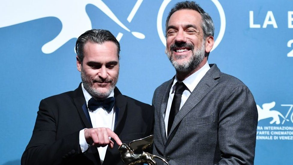 Joaquin Phoenix (left) and Todd Phillips with the best film statuette in Venice