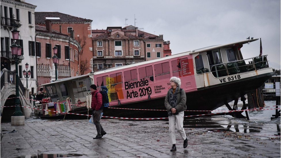 A taxi boat is stranded on the streets of Venice
