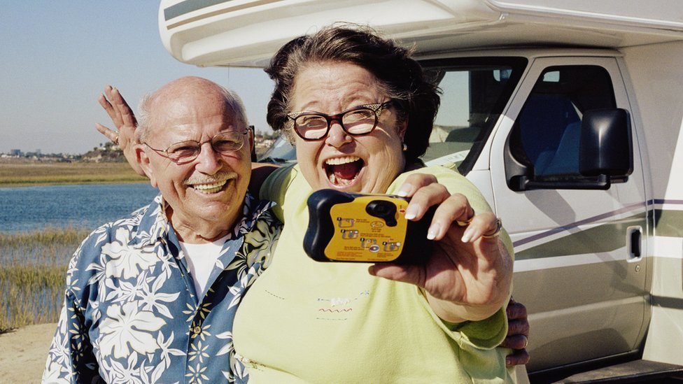 Couple holding a disposable camera