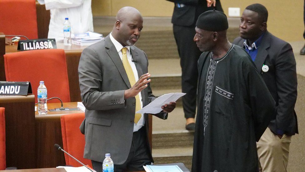 The Gambia Justice Minister Abubacarr Tambadou discusses the bill with a member of Parliament at the national assembly in Banjul, Gambia December 2, 2019.