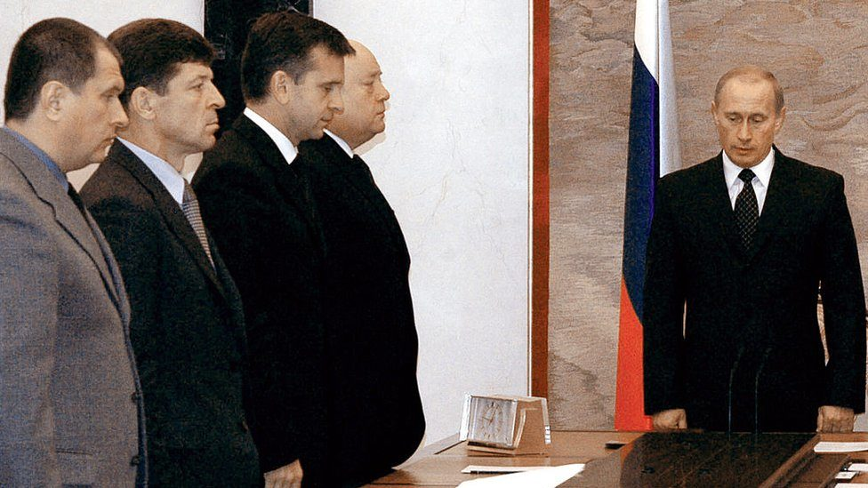 Putin and cabinet members observe a minute of silence in 2004 after the Beslan school siege
