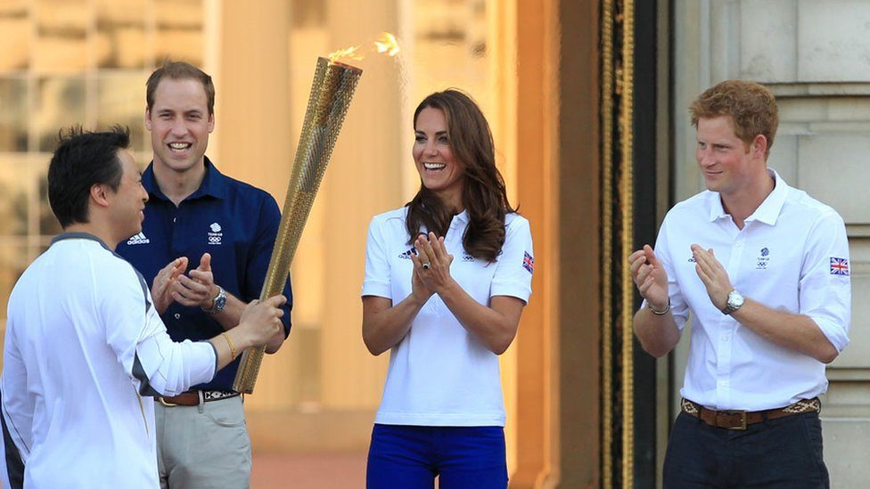 Olympic torchbearer Wai-Ming Lee, Prince William, the Duchess of Cambridge and Prince Harry in July 2012