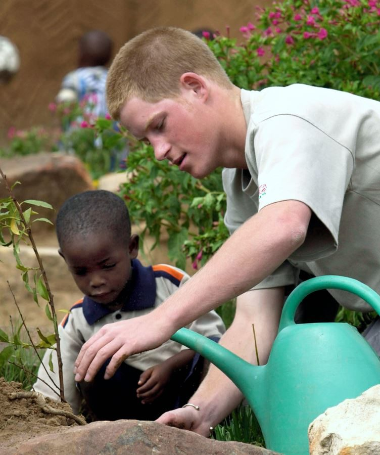 Prince Harry planting a tree at an orphanage, in Lesotho, southern Africa, 2004