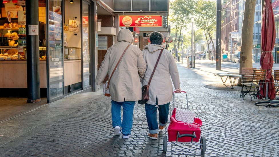 A couple walks on the street in Germany