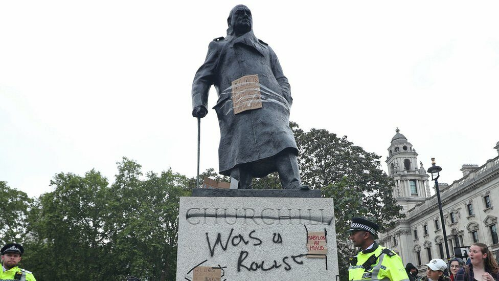 Graffiti on the Winston Churchill statue during the Black Lives Matter protest rally in Parliament Square, Westminster, London