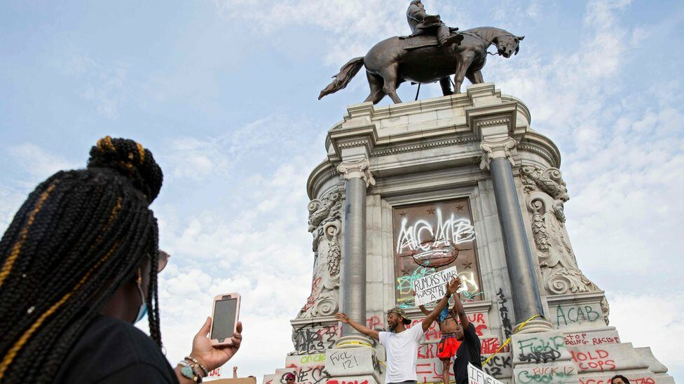 People gather around the Robert E Lee statue on Monument Avenue in Richmond, Virginia, on 4 June, 2020