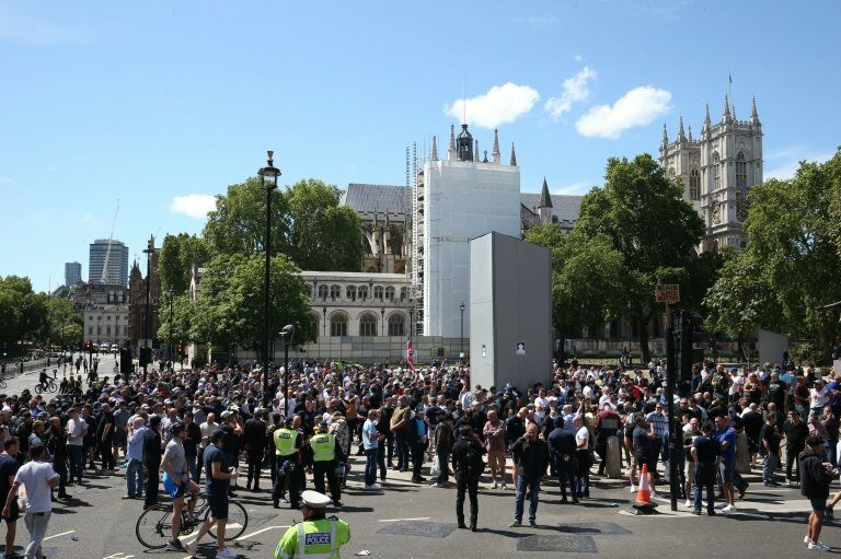 People in Parliament Square, London, before a possible protest by the Democratic Football Lads Alliance against a Black Lives Matter protest