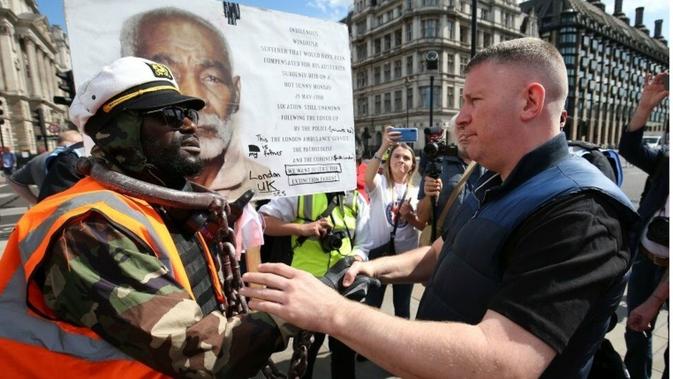 Britain First leader Paul Golding (right) shakes hands with a protester in Parliament Square, London before a possible protest by the Democratic Football Lads Alliance against a Black Lives Matter protest.