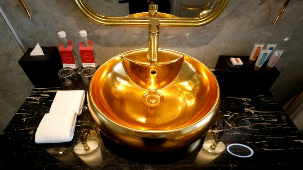 A gold-plated bathroom sink is seen in the newly inaugurated Dolce Hanoi Golden Lake luxury hotel