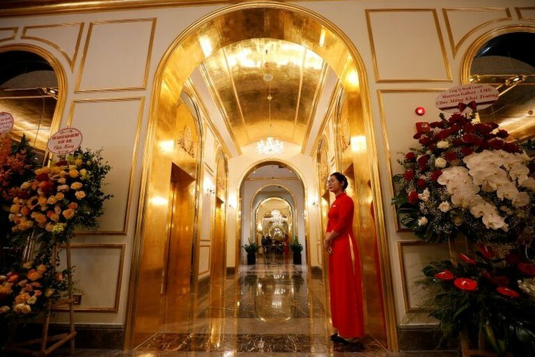 An employee in traditional dress is seen in the newly-inaugurated Dolce Hanoi Golden Lake luxury hotel
