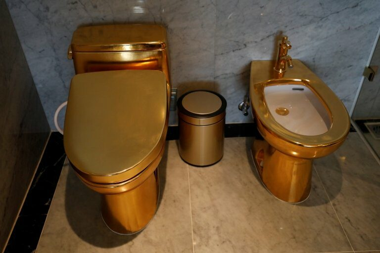 Gold plated toilets are seen at the newly-inaugurated Dolce Hanoi Golden Lake hotel