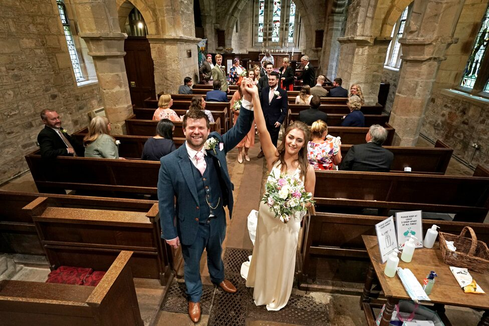 The newly married Mr and Mrs Bone, Lucy and James, pose after their wedding at St Michael and all Angels Church in Ingram, Northumberland