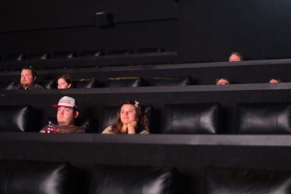 People sit in a cinema