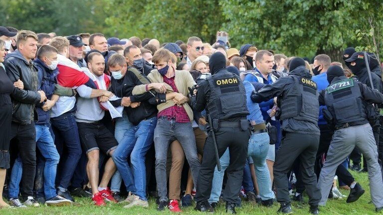 Scuffles between riot police and demonstrators in Minsk - 13 September
