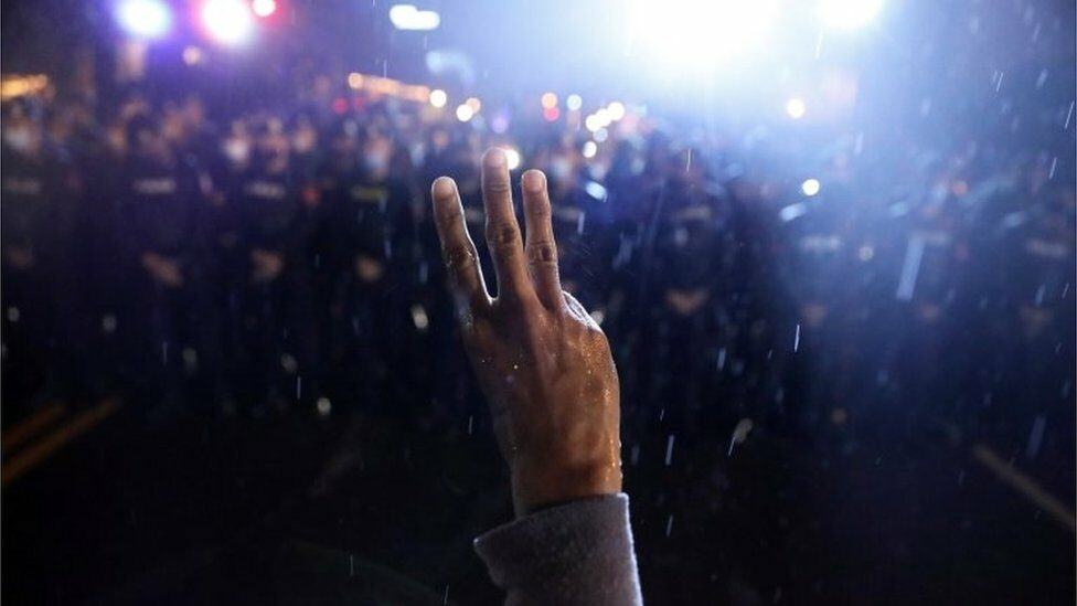 A protestor shows the three-finger salute during anti-government protests, in Bangkok, Thailand October 16, 2020.