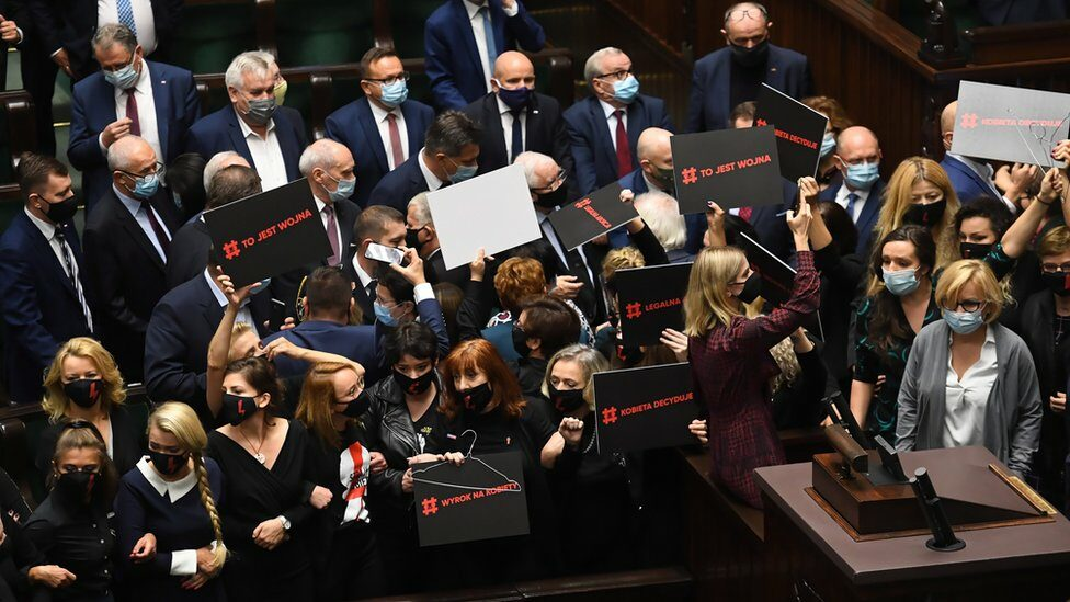 """Female opposition deputies block the rostrum of the Sejm as the """"For Life"""" programs were announced in the Lower House in Warsaw"""