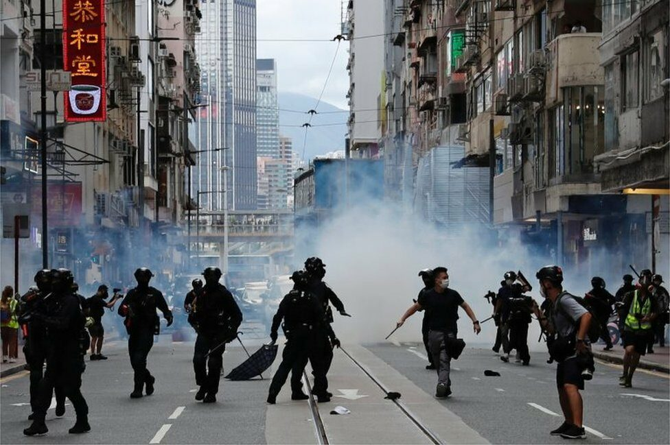 """Riot police fire tear gas into the crowds to disperse anti-national security law protesters during a march at the anniversary of Hong Kong""""s handover to China from Britain in Hong Kong, China July 1, 2020."""
