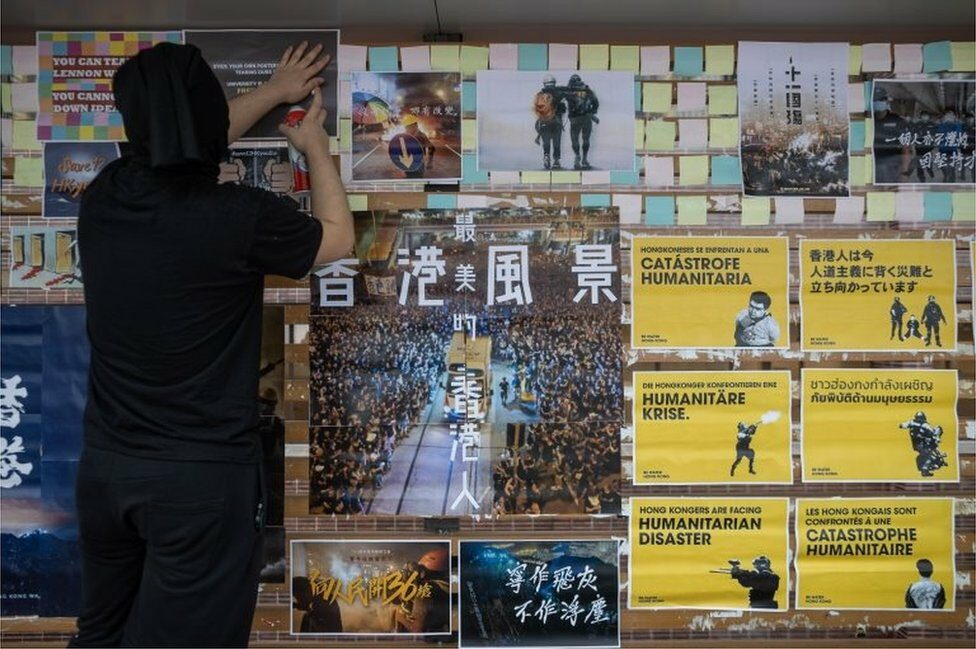 """University of Hong Kong students take part in rebuilding a """"Lennon Wall"""" on the campus in Hong Kong, China, 29 September 2020."""