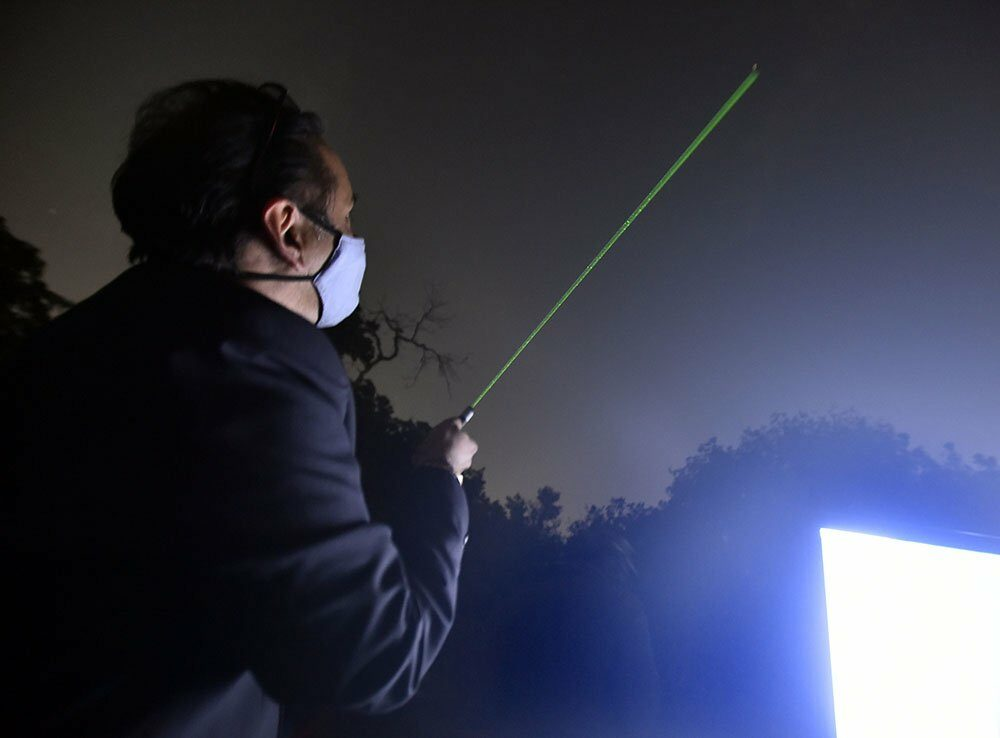 A man uses a laser pointer