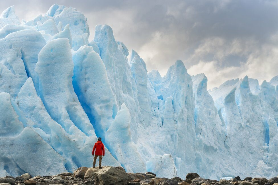 Man standing on a glacier in Argentina