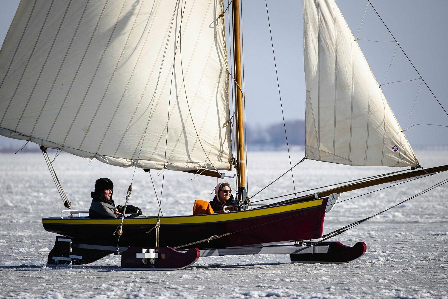 People are ice sailing on the Gouwzee in the Netherlands, 12 February 2021.