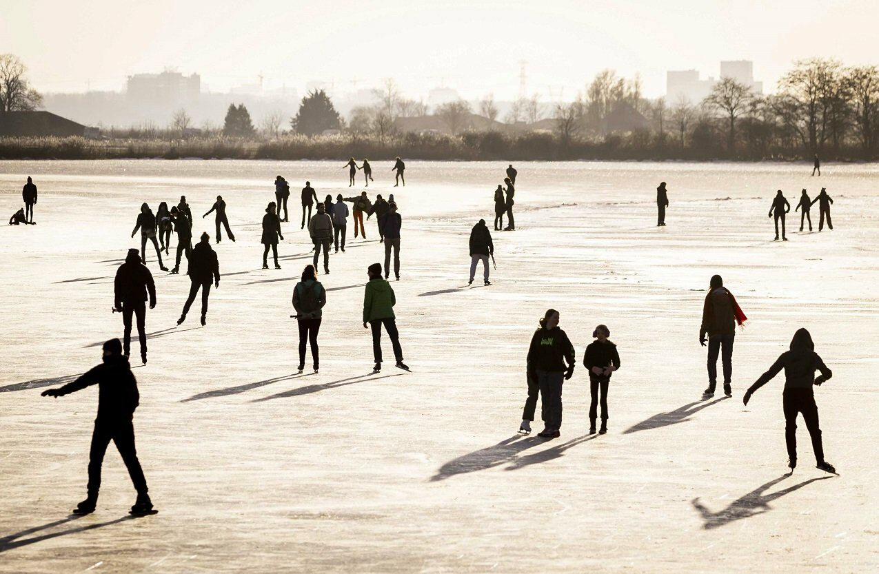 People skate on natural ice in Zuiderwoude, The Netherlands, 11 February 2021.