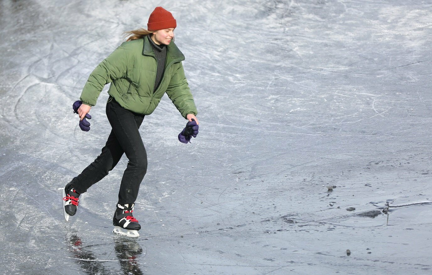 A woman ice skates during a cold snap across the country at the Prinsengracht in Amsterdam, Netherlands February 14, 2021.