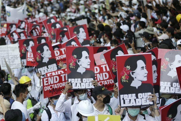 Demonstrators hold placards calling for the release of detained civilian leader Aung San Suu Kyi during a protest against the military coup, in Yangon, Myanmar, 25 February 2021