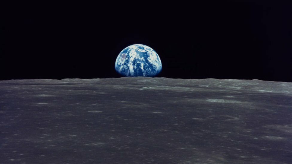 Earth rise, photographed by Apollo 11 on July 1969.