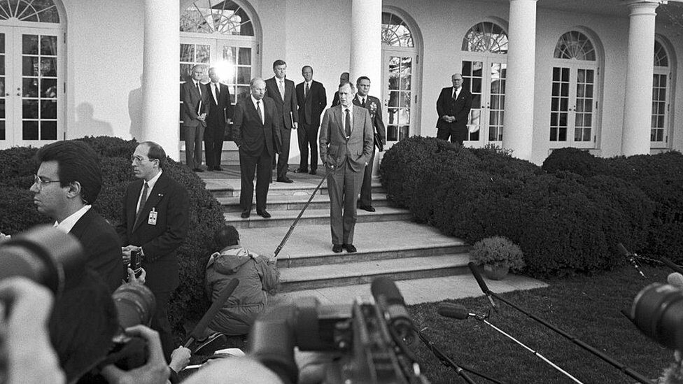 George HW Bush at the White House in 1991, with Dick Cheney and Colin Powell, prior to commencement of Desert Storm