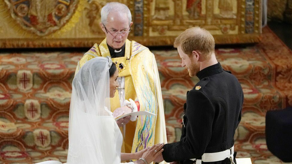 Prince Harry and Meghan Markle exchange vows in front of Justin Welby, the Archbishop of Canterbury, during their wedding ceremony in St George's Chapel at Windsor Castle on May 19, 2018 in Windsor,
