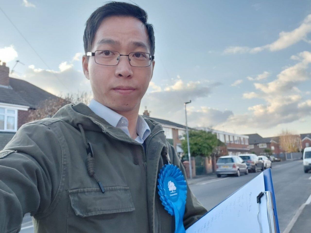 Timothy Cho takes a selfie wearing a Conservative Party rosette