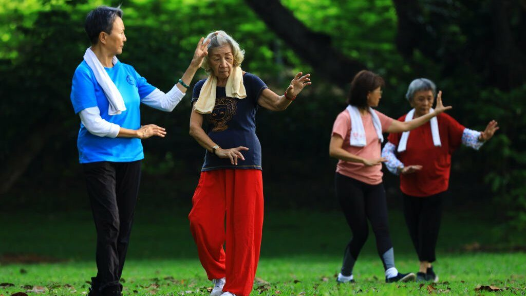 People exercise at a park on 10 April 2021 in Singapore