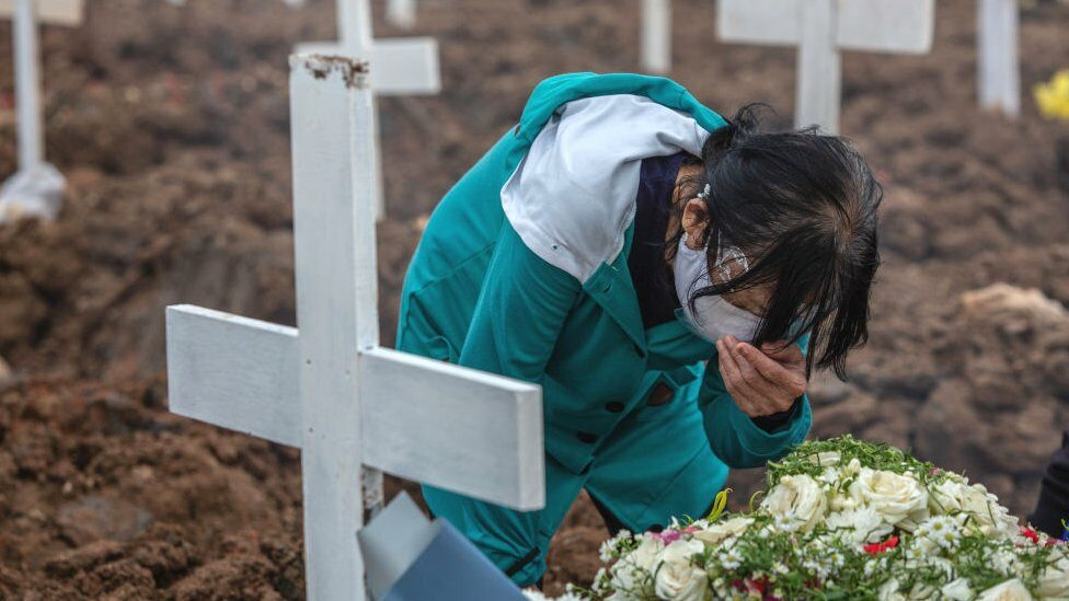 A woman crying during the burial of a daughter who died of COVID-19 at Rorotan Cemetery in Jakarta on Tuesday 13 July, 2021.