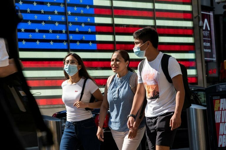 People wear masks around Times Square, as cases of the infectious coronavirus Delta variant continue to rise in New York City, New York, U.S., July 23, 2021.