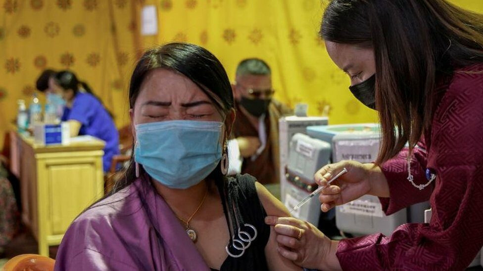 A health worker inoculates a woman at a temporary vaccination centre in Thimpu, Bhutan, on July 26