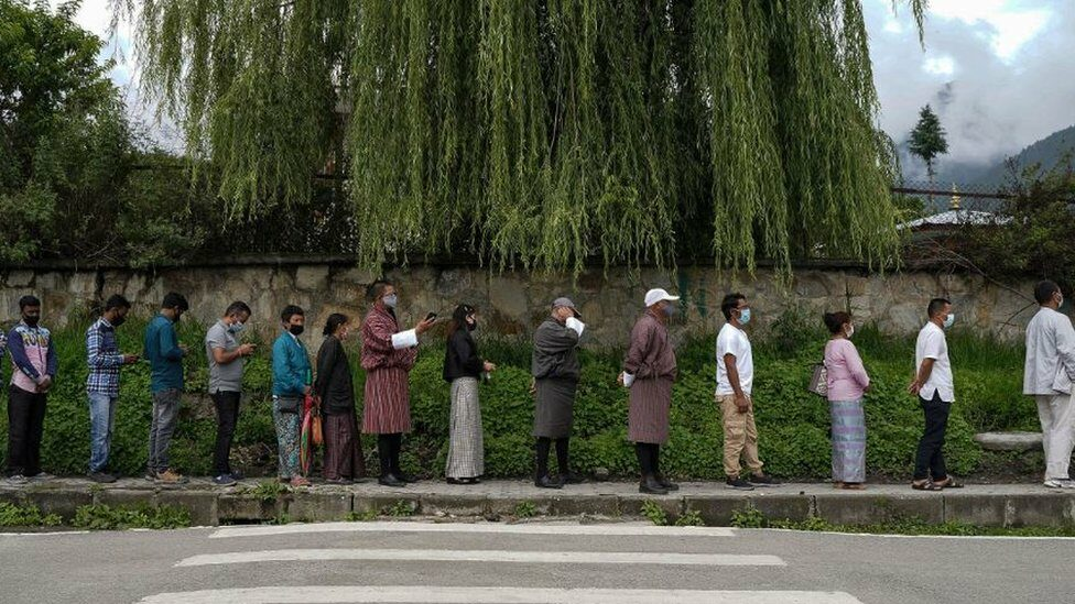 People queue up to register themselves and get inoculated with the Covid-19 coronavirus vaccine at a temporary vaccination centre in Thimpu