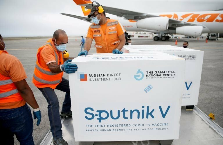 """Workers take care of the shipment of Russia""""s Sputnik V vaccine in Caracas, Venezuela March 29, 2021"""