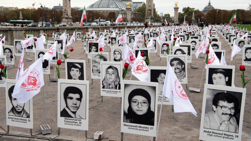 Some 800 portraits of political prisoners who were executed in Iran in 1988 after displayed by representatives in France of the People's Mujahedin Organization of Iran on the Esplanade des Invalides in Paris (29 October 2019)