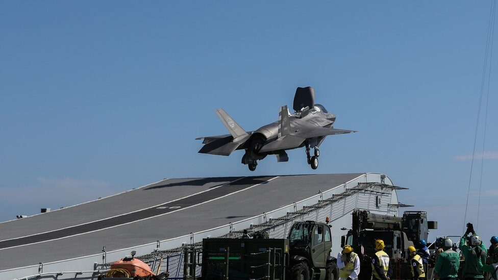 Ski-jump ramps allow aircraft to take off with high payloads.  But it's not as good as a steam-powered ejection system.