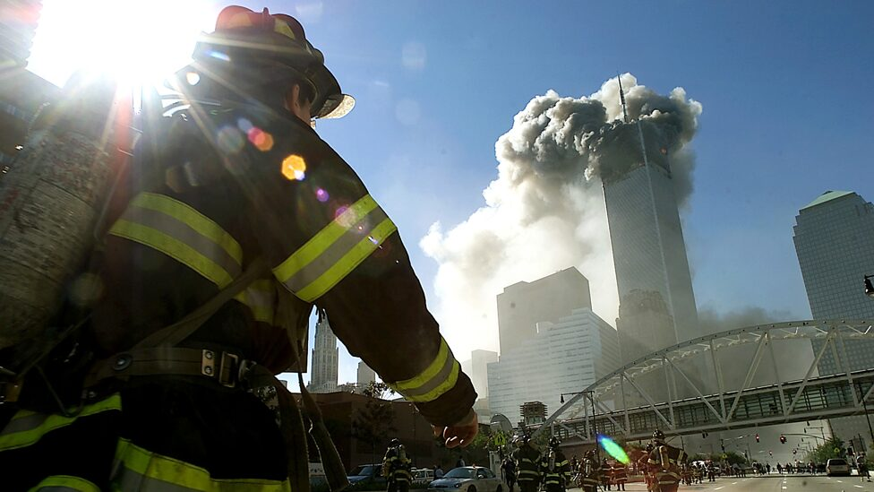 Firefighters walk towards one of the tower at the World Trade Center before it collapsed after a plane hit the building September 11, 2001 in New York City.
