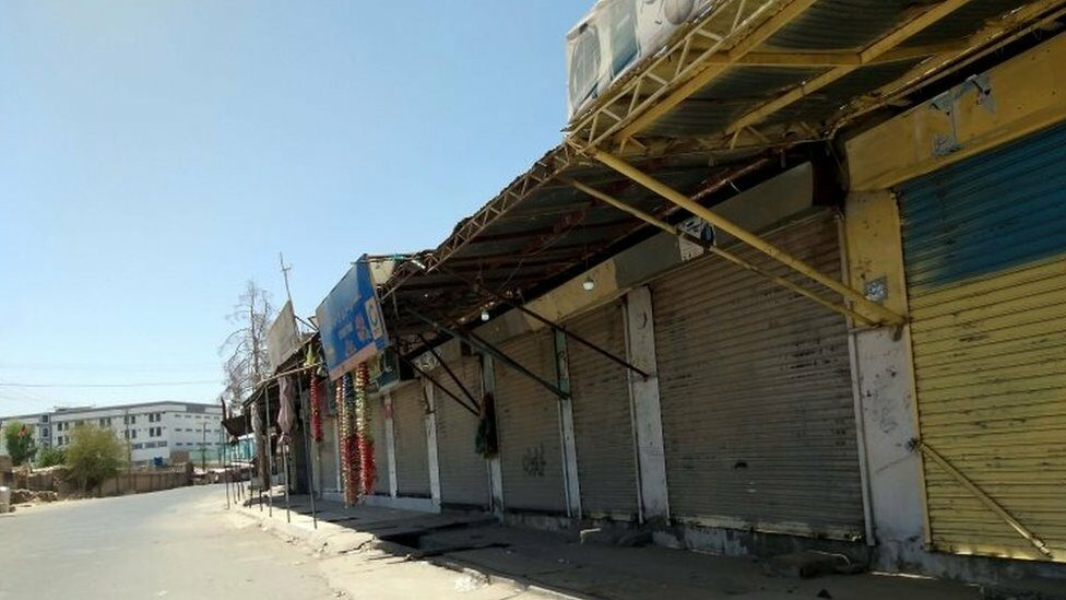 A picture of a damaged market in Lushker Gah on Monday (Aug 2).